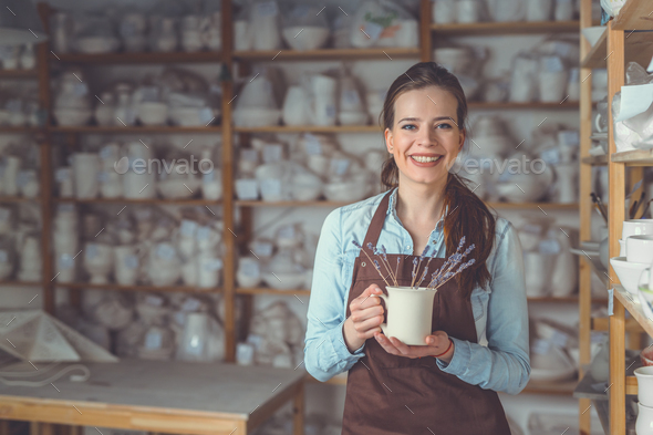 Young girl with a ceramic vase - Stock Photo - Images