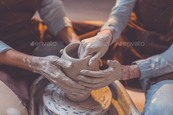 Human hands at the potter's wheel - Stock Photo - Images