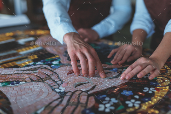 Human hands at artwork - Stock Photo - Images