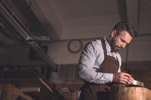 Young master at work in studio - Stock Photo - Images