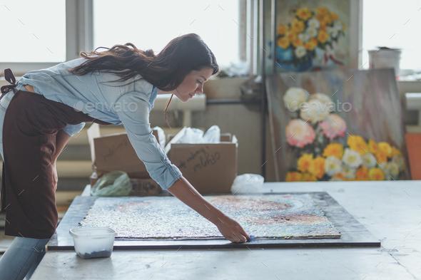 Young woman with a mosaic - Stock Photo - Images