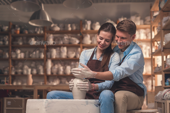 Smiling couple in pottery - Stock Photo - Images