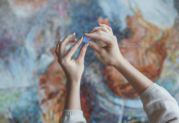 Female hands with a mosaic - Stock Photo - Images