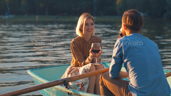Young attractive couple in a boat - Stock Photo - Images