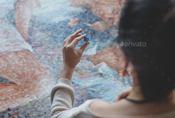 Young woman with a mosaic in studio - Stock Photo - Images