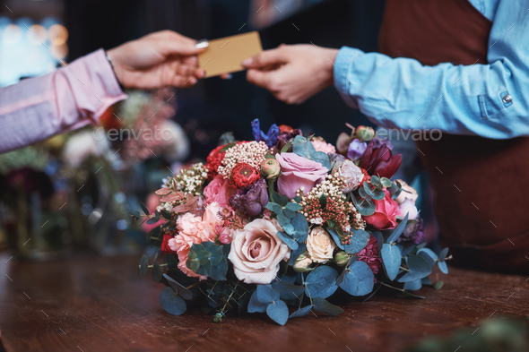 Young girl buying a bouquet - Stock Photo - Images
