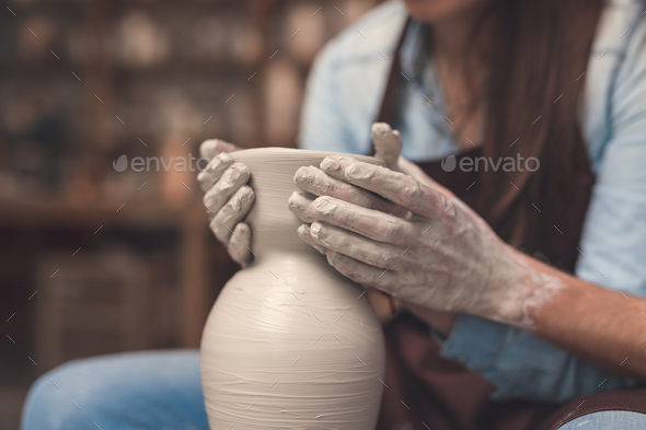 Young couple in pottery closeup - Stock Photo - Images