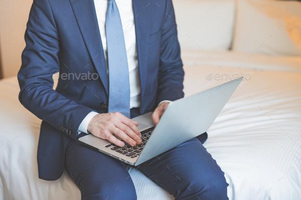 Young businessman with laptop closeup - Stock Photo - Images
