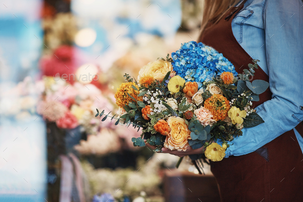 Young girl with bouquet in the store - Stock Photo - Images