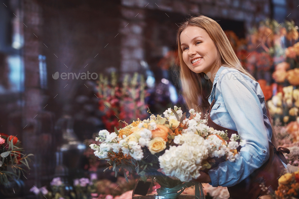 Smiling girl with flowers - Stock Photo - Images