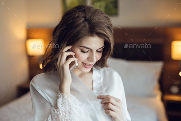 Young attractive woman talking on a phone - Stock Photo - Images