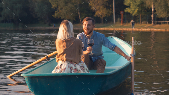 Young smiling couple in a boat - Stock Photo - Images