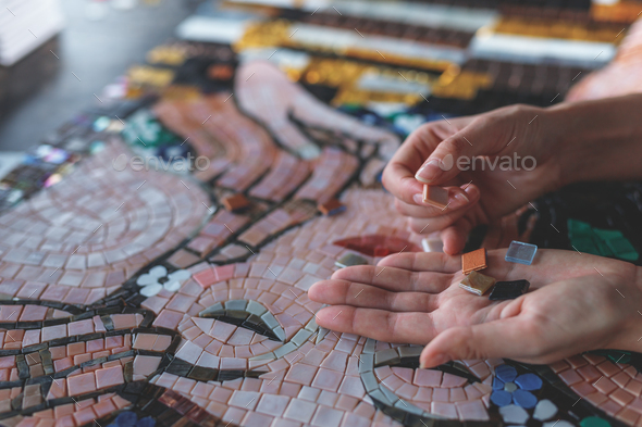 Female hands with mosaic - Stock Photo - Images