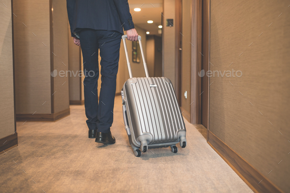 Young businessman on a business trip - Stock Photo - Images