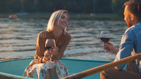 Smiling couple in a boat - Stock Photo - Images