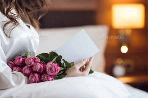 Young woman with flowers - Stock Photo - Images