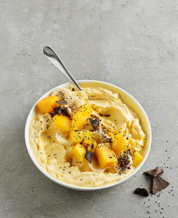 smoothie bowl of frozen banana and mango - Stock Photo - Images