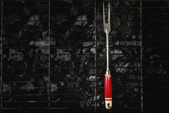 Barbeque fork on charcoal - Stock Photo - Images