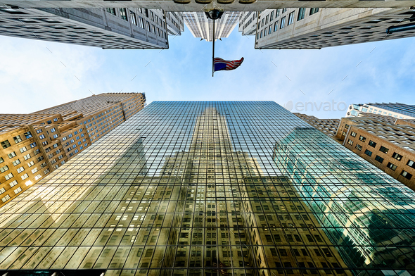 Building reflection in windows of another building in New York - Stock Photo - Images