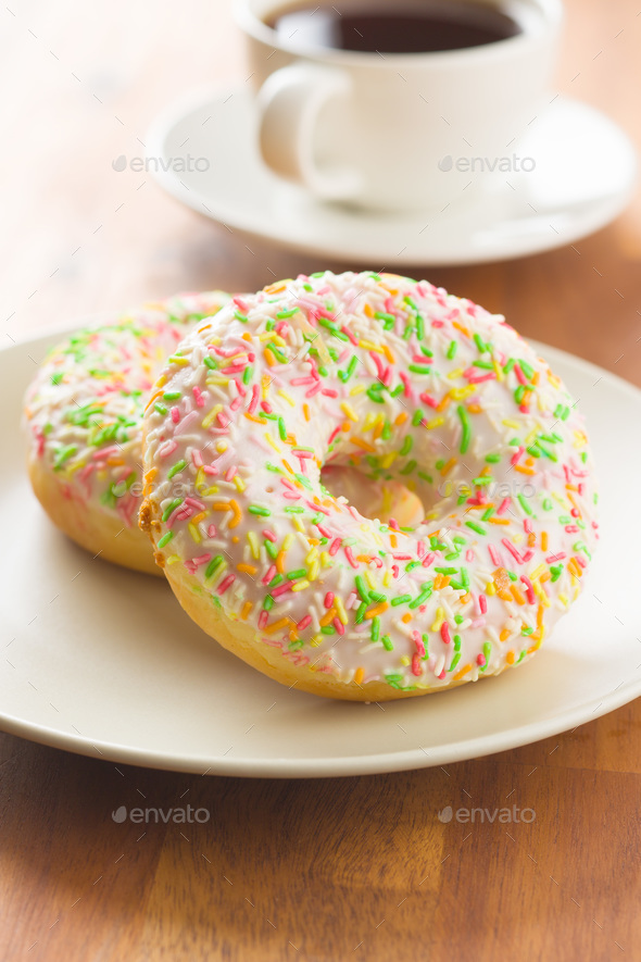 Sweet sprinkled donuts. - Stock Photo - Images