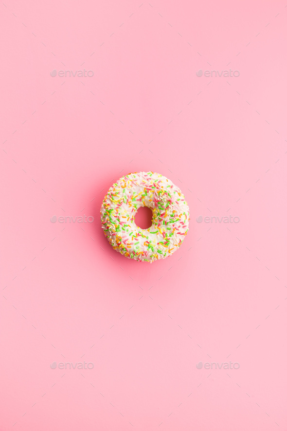 Sweet sprinkled donut. - Stock Photo - Images
