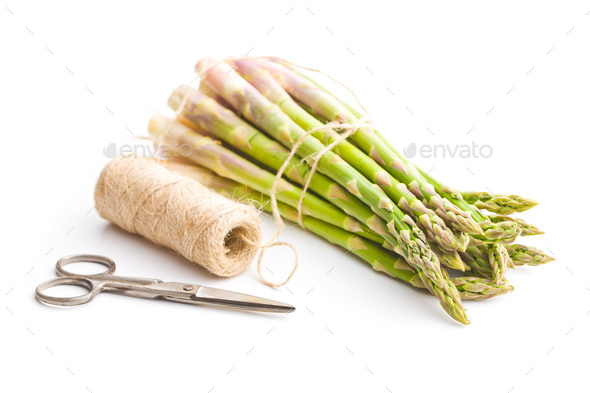 Fresh green asparagus with scissors and thread. - Stock Photo - Images