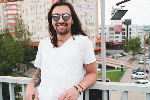 Smiling man in sunglasses enjoying life - Stock Photo - Images
