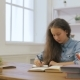 Young Girl with Laptop Computer Is Doing Homework. College Education. Female Student Is Studying - VideoHive Item for Sale