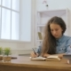 Young Girl with Laptop Computer Is Doing Homework - VideoHive Item for Sale