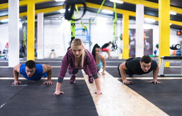 young healthy people doing pushups - Stock Photo - Images