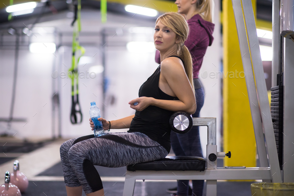 woman exercise with fitness kettlebell - Stock Photo - Images
