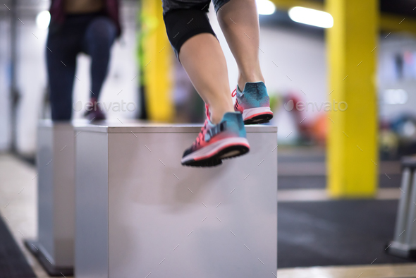 athletes working out  jumping on fit box - Stock Photo - Images