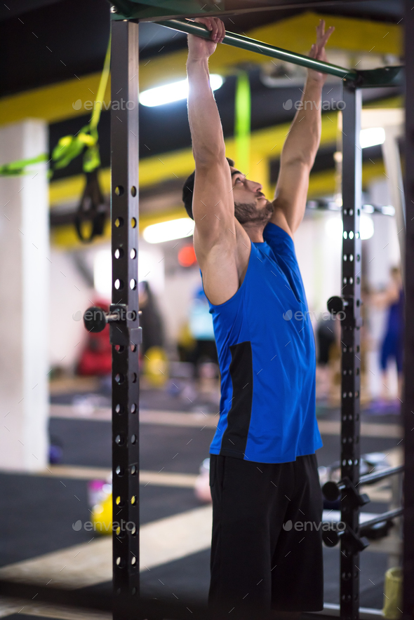 man doing pull ups on the horizontal bar - Stock Photo - Images