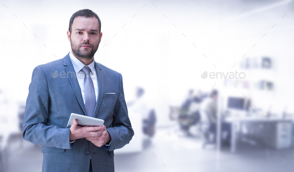 Young businessman in his office - Stock Photo - Images