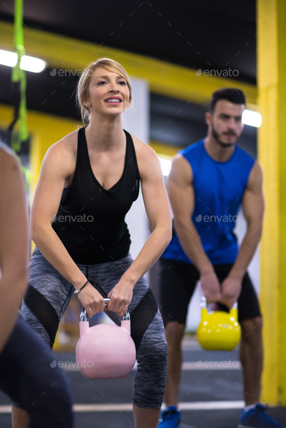 athletes doing exercises with kettlebells - Stock Photo - Images