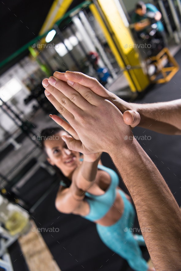 young athletes making high five - Stock Photo - Images