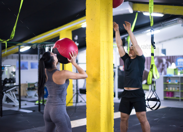 young athletes couple working out with medical ball - Stock Photo - Images