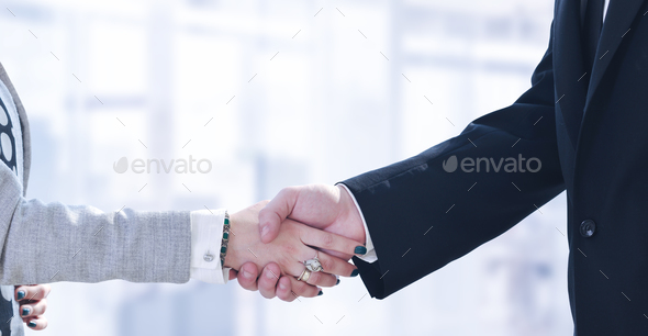 Businessman and businesswoman shaking hands after meetup - Stock Photo - Images