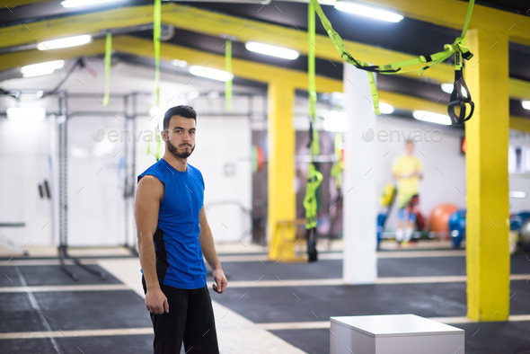 portrait of young man at cross fitness gym - Stock Photo - Images