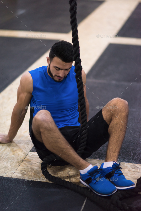 man relaxing before rope climbing - Stock Photo - Images