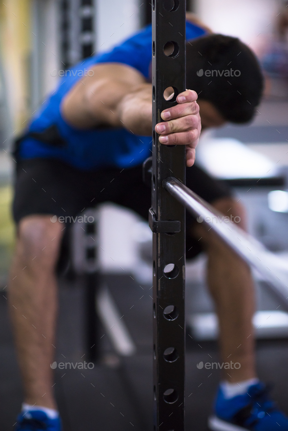 man doing pull ups on the vertical bar - Stock Photo - Images