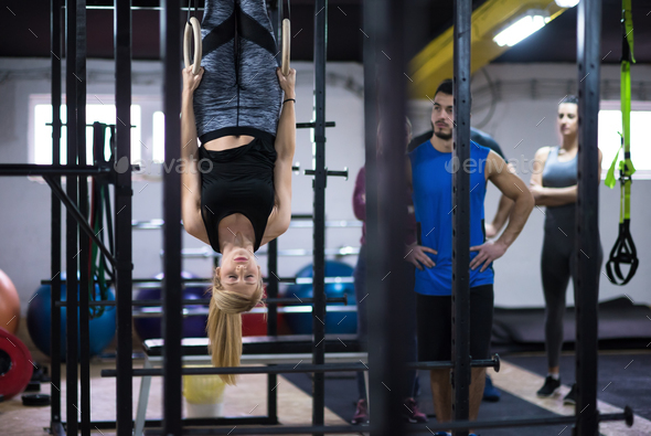 woman working out with personal trainer on gymnastic rings - Stock Photo - Images