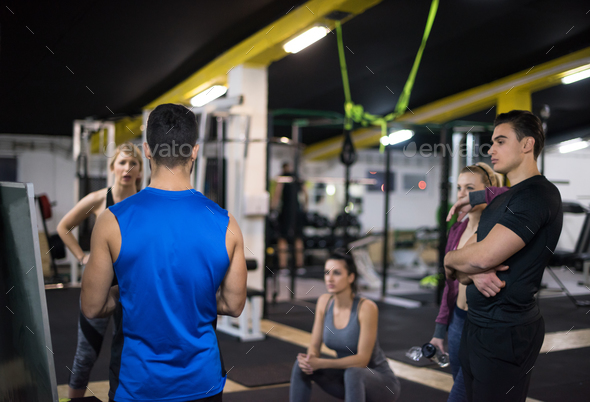 athletes getting instructions from trainer - Stock Photo - Images