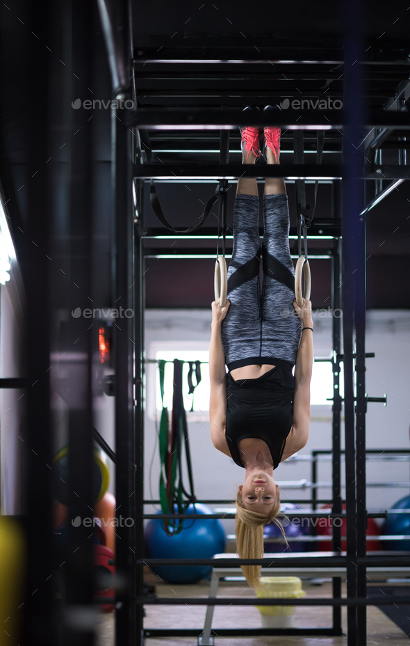woman working out on gymnastic rings - Stock Photo - Images