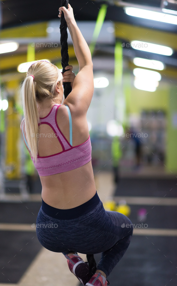 woman doing rope climbing - Stock Photo - Images