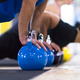 young athletes doing pushups with kettlebells - PhotoDune Item for Sale