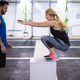 woman working out with personal trainer jumping on fit box - PhotoDune Item for Sale