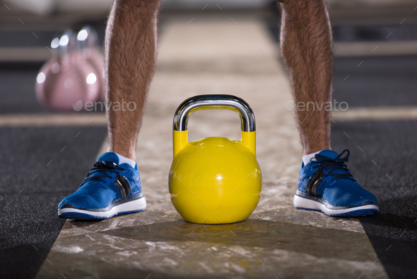 man exercise with fitness kettlebell - Stock Photo - Images
