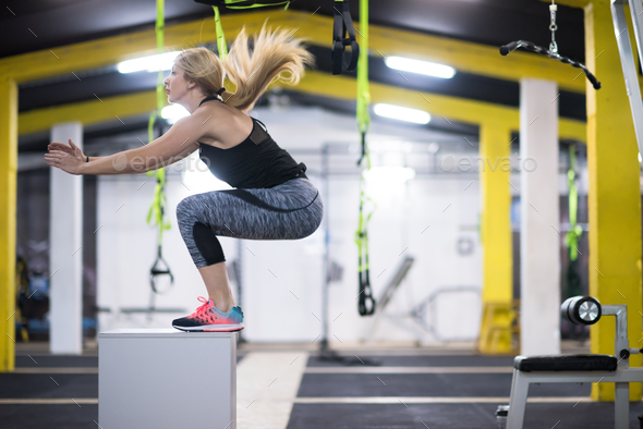 woman working out  jumping on fit box - Stock Photo - Images