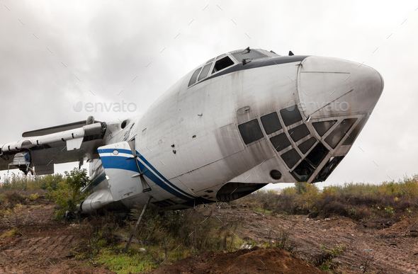 Broken airliner on the ground - Stock Photo - Images
